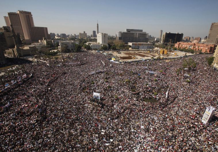 Opposition supporters attend Friday prayer in Tahrir Square in Cairo February 11, 2011. Credit: Reuters