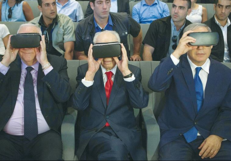 PRESIDENT REUVEN RIVLIN, former president Shimon Peres, and Prime Minister Benjamin Netanyahu don virtual reality goggles at the Peres Center for Peace and Innovation in Jaffa