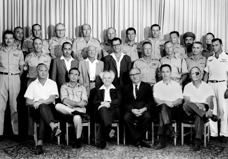Then-Defense Ministry director-general Shimon Peres (seated second right) attends a meeting of the IDF General Staff with prime minister David Ben-Gurion in 1961. Peres is sitting between then-finance minster Levi Eshkol and then-agriculture minister Moshe Dayan (photo credit: GPO)