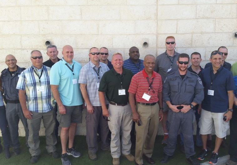 THE ADL delegation of senior US law enforcement officials poses with Israel Police officers in Jerusalem.