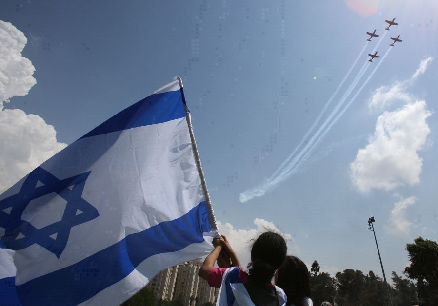 Israelis gather to watch the annual Independence Day flyover.
