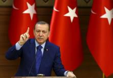Turkish President Recep Tayyip Erdogan makes a speech at the Presidential Palace in Ankara