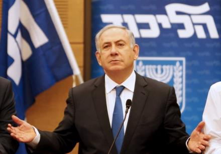 Prime Minister Benjamin Netanyahu (C) attends a meeting of the Likud party