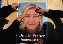 SUPPORTERS OF Marine Le Pen put up a poster earlier this year. There has been a meteoric rise of rig