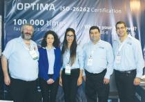 THE OPTIMA team poses at the 2016 ChipEx Conference in Tel Aviv.