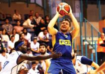 Maccabi Tel Aviv guard Gal Mekel (shooting) scored a team-high 14 points in last night' 84-65 win ov