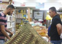 Muslim residents of Jerusalem's Old City prepare on Thursday for Ramadan, which begins today.