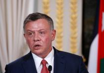 Jordan's King Abdullah attend a joint news conference following a meeting with the French president