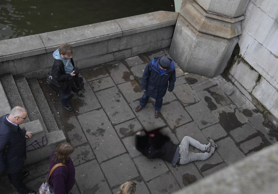 A man lies injured after a shooting incident on Westminster Bridge in London, March 22, 2017 (Reuters)