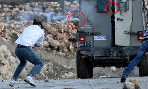 Tamimi (left) a moment before his injury; ; Emphasis on barrels added by Popular Struggle Coordination Committee.