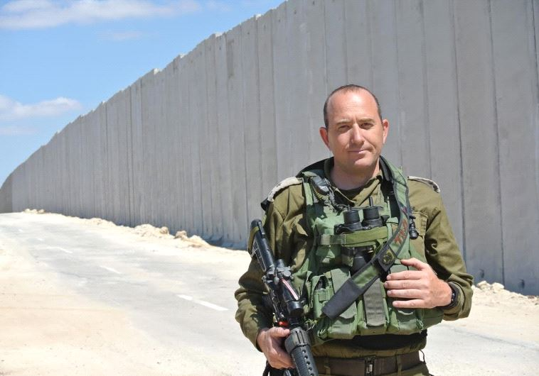 Battalion commander Lt. Col Tsafrir Harshoshanim stands along the new fence being built on the Lachish region border with Hebron hills.