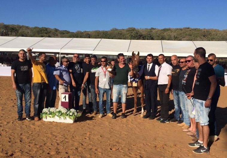 """""""Nabella Ajman"""" a champion horse strikes a pose with her owners and trainers"""